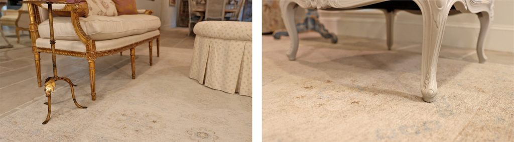 Closeup view of the legs on Amitha Verma's furniture on top of her neutral living room rug.