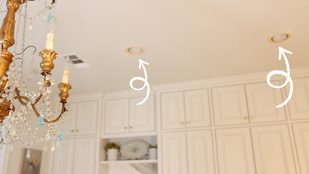 Arrows pointing to the recessed lighting installed into Amitha's kitchen ceiling.