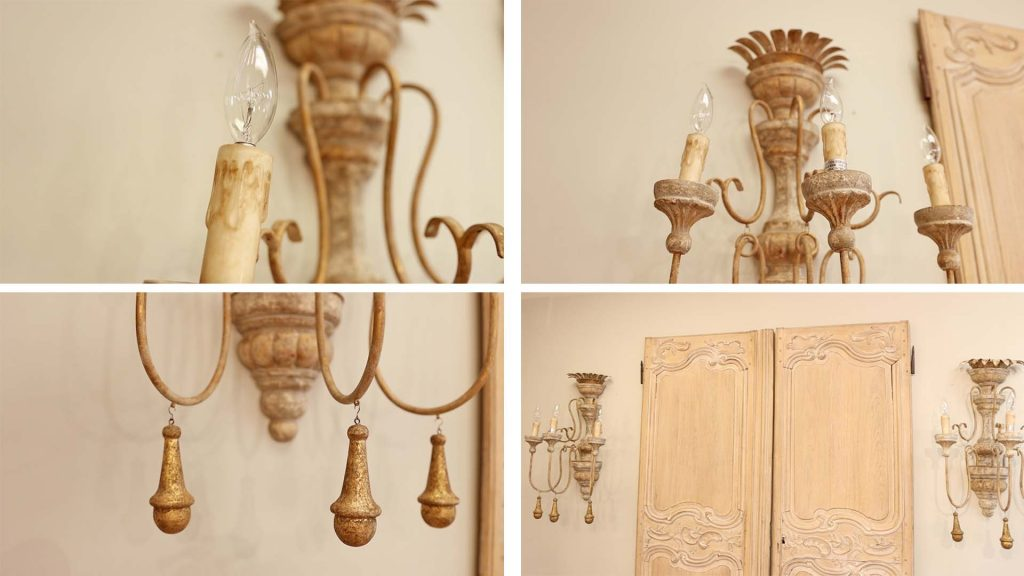 Closeup features of gold chippy wall sconces at Village Antiques.